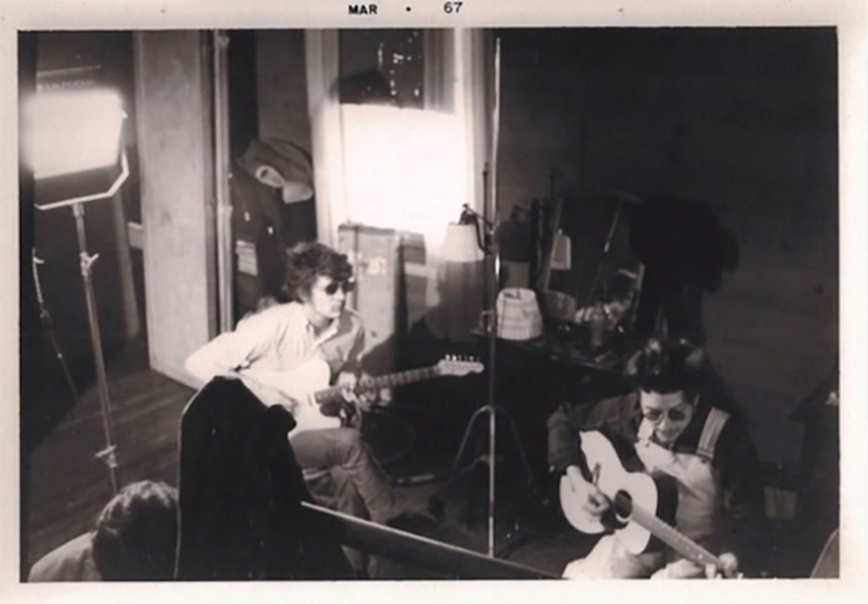 Dylan strumming away at his new pile of lyrics, later known as the Basement Tapes, in March 1967 // photo from Stephen Badolato (Youtube)
