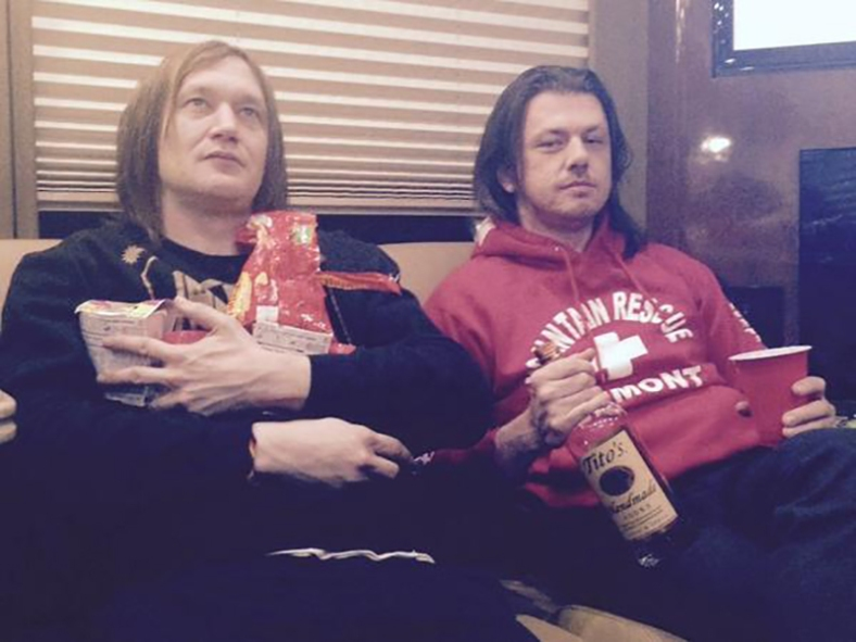 Members of Interpol shacking up with tour bus food and alcohol to stave off the blizzard outside // via Interpol's Twitter