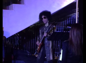 Prince wailing out a two-minute solo for a pleasantly surprised crowd.